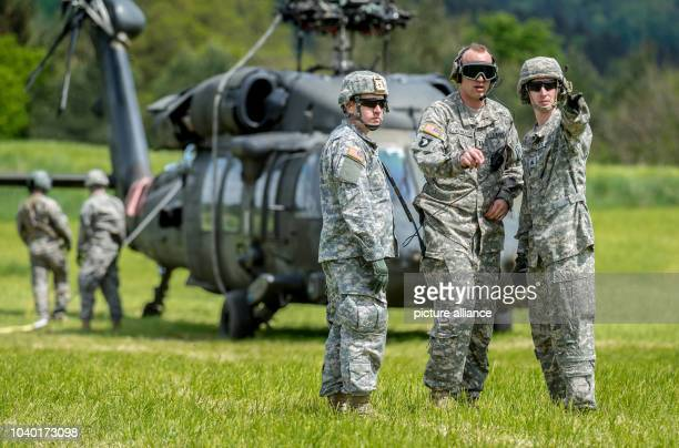 USArmy soldiers stand in front of a Sikorsky UH60 Black Hawk helicopter in Plankenfels Germany 18 May 2015 The pilots of the helicopter had to make...