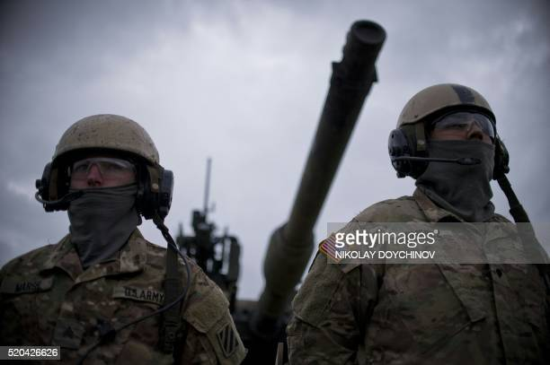 US army soldiers stand in front of US M1 Abrams tank during a joint military tactical training exercise Blowback 2016 with Bulgaria's army at Novo...