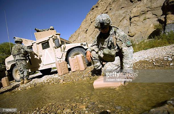 Army soldiers use Arghandab River water to fill their 5 gallon containers near Forward Operating Base Mizan in Zabul Province, Afghanistan September...