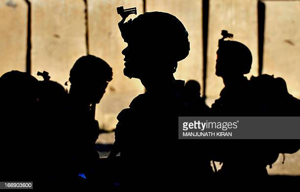 US army soldiers wait for orders at the Forward Base Honaker Miracle at Watahpur District in Kunar province prior to a joint patrol led by the Afghan...