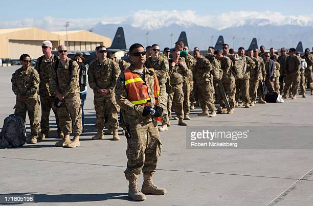 S Army soldiers wait to board their C17 cargo plane for departure May 11 2013 at Bagram Air Base Afghanistan US soldiers and marines are part of the...