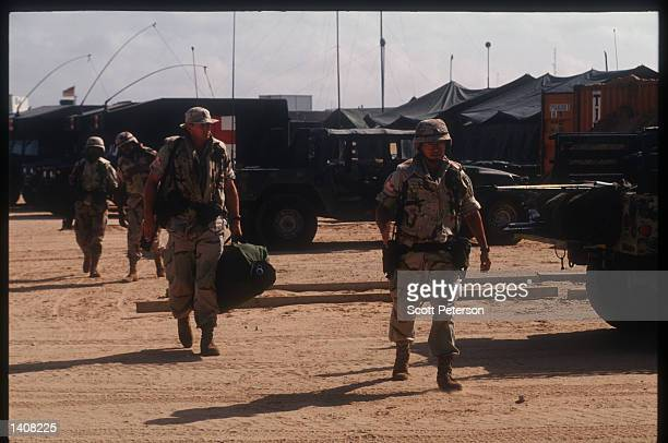 US army soldiers walk October 13 1993 in Mogadishu Somalia Two US Army Airborne Ranger''s helicopters were shot down October 3 1993 during a...