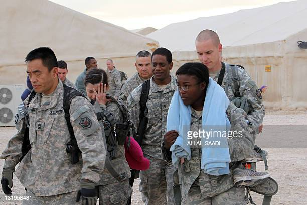 US army soldiers walk to board a plane to begin their journey home out of Iraq from the alAsad Air Base west the capital Baghdad on November 1 2011...