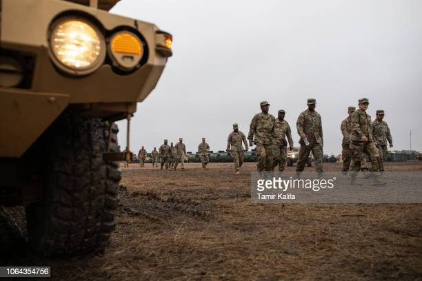 S Army soldiers walk toward the mess tent where troops deployed to the USMexico border are enjoying a Thanksgiving meal on a base near the DonnaRio...