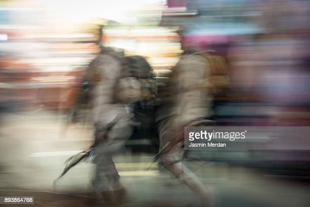 army soldiers walking between crowded people blurred motion walking - shi'ite islam stock pictures, royalty-free photos & images