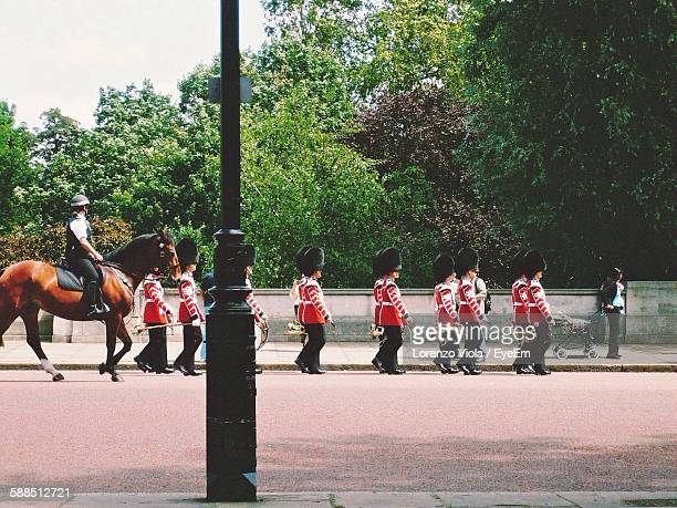 army soldiers with horse marching on road during parade - パレード ストックフォトと画像