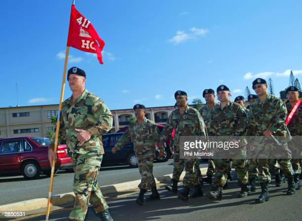 Army soldiers with the 411th Engineer Battalion, 9th Support Command of the Pacific Army Reserve march in formation during their first day of duty at...
