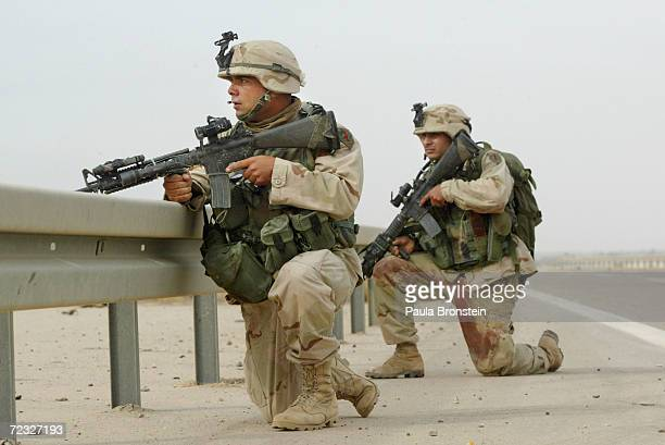 S Army soldiers with the 82nd Airborne First Infantry Division respond to gunfire in the distance November 8 2003 in Fallujah Iraq Two soldiers were...