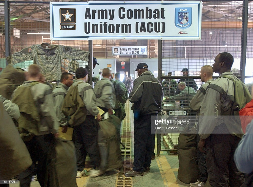 S. Army soldiers with the Georgia National Guard's 48th Infantry Brigade assemble to receive the new Army Combat Uniform (ACU) February 8, 2005 at Fort Stewart, Georgia. The ACU includes a new universal camouflage pattern and provides moisture wicking, functionality and ergonomics.
