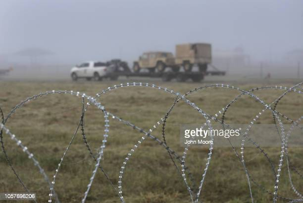 S Army soliers move heavy equipment in the morning fog near the USMexico border on November 5 2018 in Donna Texas Troops had set up razor wire there...