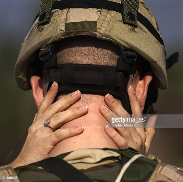 Army Spc. Bryan Pierce gets a hug from his girlfriend Courtney Brown during the deployment of the 3/7th infantry brigade of the 3rd Infantry Division...