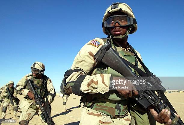 S Army Spc Jerome Davis from Long Beach California participates in urban warfare training January 13 2003 near the Iraqi Border in Kuwait US soldiers...