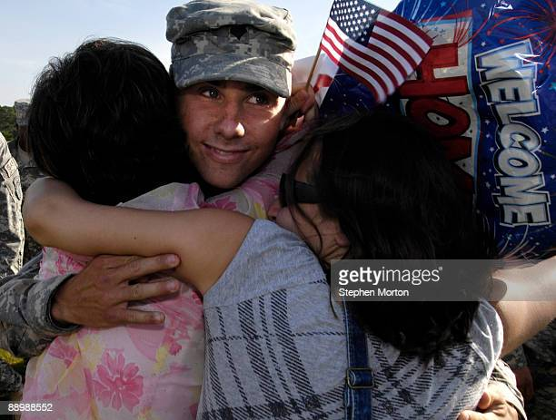 Army SPC Kirk Jones is welcomed home by his mother Georgia Jones and sister Emily Jones during a homecoming ceremony for more than 130 Soldiers with...