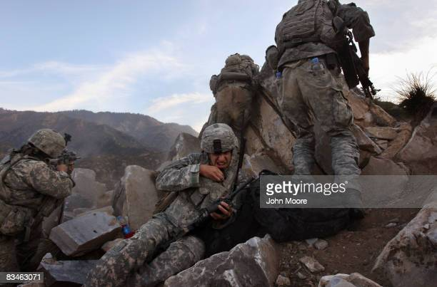 Army Spc. Kyle Stephenson grimaces from the sound of outgoing shots during a firefight October 28, 2008 in the Korengal Valley in eastern...