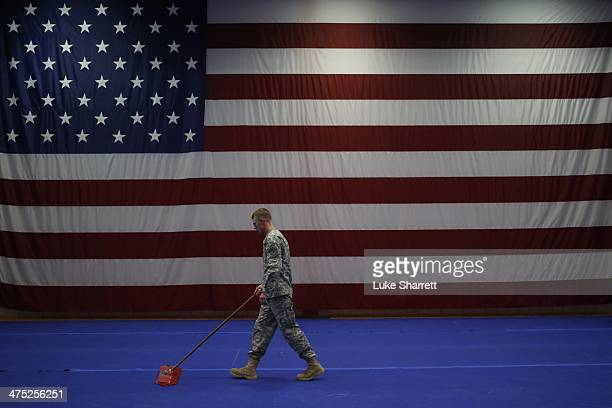 Army Spc Nathan Bookout sweeps the floor following a welcome home ceremony for members of the US Army's 3rd Brigade Combat Team 1st Infantry Division...