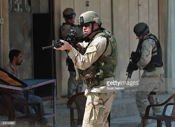 S Army Special Forces 'Ateam' conducts a raid to capture a high level Saddam Fedayeen leader in the town of Samarra Iraq The intended target of the...