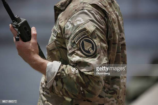A US Army Special Forces soldier holds a radio before an International Special Operations Forces capacities exercise rehearsal outside the Special...