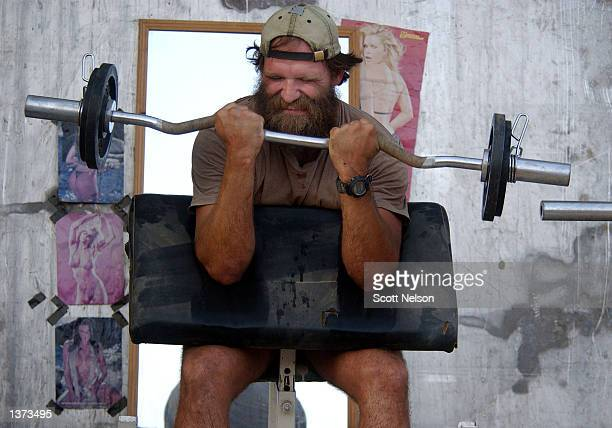 S Army Special Forces soldier nicknamed 'Cowboy' lifts weights at the SF safe house August 31 2002 in Kunduz Afghanistan US Special Forces have...