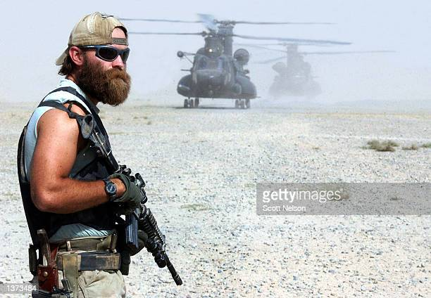 S Army Special Forces soldier nicknamed 'Cowboy' secures an airstrip during an operation August 28 2002 in the town of Taloquan in Northern...