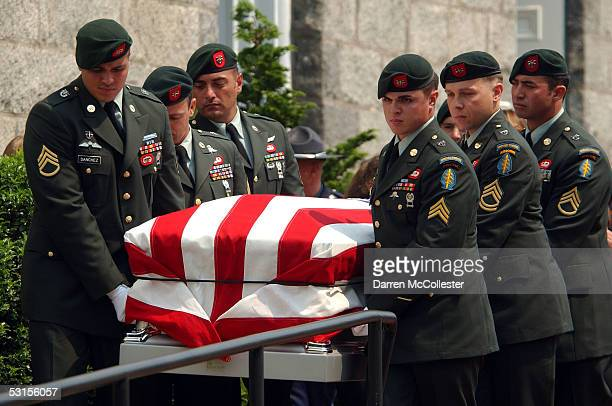 Army Special Forces soldiers carry the casket of their fallen comrade, Army Staff Sgt. Christopher Piper June 27, 2005 during his funeral procession...