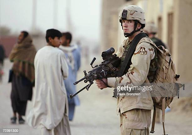 S Army Specialist John Pendergrass with the Charlie Co 151st Infantry Brigade from Fort Wayne Indiana scans the area on patrol on October 17 2004 in...