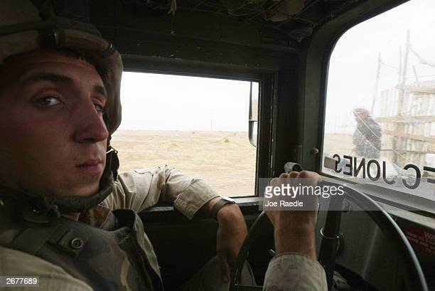 S Army Specialist Joshua Stevens from Westmoreland Tennessee of the 101st Airborne Rakkassan regiment drives a humvee as he patrols along an oil...