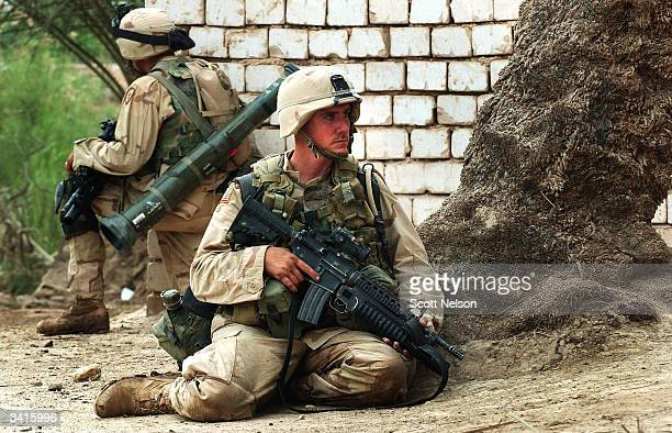 S Army Specialist Nicholas Brenner from Modesto Caifornia holds a cover position with other soldiers from the 1st Battalion 14th regiment of the 25th...