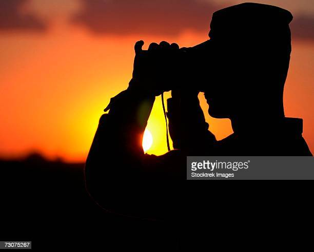 U.S. Army Specialist scans the horizon at the U.S.- Mexican border in San Luis, Arizona, July 30, 2006.
