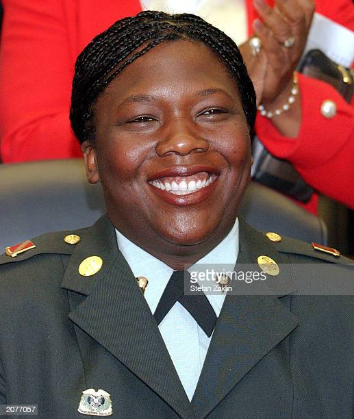S Army Specialist Shoshana Johnson smiles as members of the Congressional Black Caucus applaud her on Capitol Hill June 12 2003 in Washington DC...