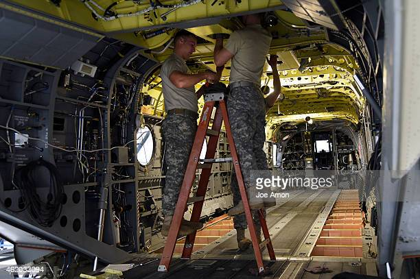 Army specialists working on CH47 Chinooks in the 2nd of the 135th Aviation Regiment General Support Aviation Battalion at Buckley Air Force Base in...