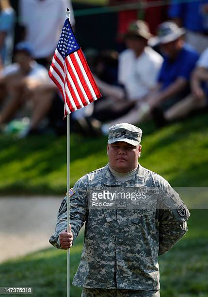 Army SSG Joshua Feheran of Guam holds the pin on the 17th hold during Round One of the ATT National at Congressional Country Club on June 28 2012 in...