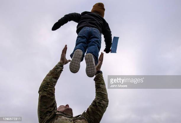 Army SSG. Matthew Peters plays with his son Eli upon returning home from a 9-month deployment to Afghanistan on December 10, 2020 at Fort Drum, New...