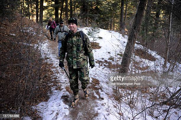 S Army Staff Sergeant Nick Denning walks on a trail as he takes part in an ice climbing trip as he takes part in the LifeQuest Music Camp on Friday...