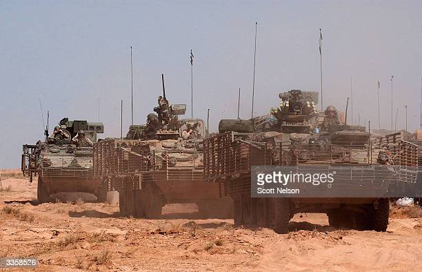 S Army Stryker armored vehicles push out from forward operating base April 14 2004 about 12 miles outside the holy Iraqi city of Najaf Iraq Soldiers...