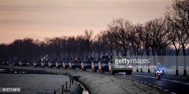 TOPSHOT Army tank vehicles line up at the Johannes Postkazerne military base to drive to Steenwijk train station to be transported to Germany for the...