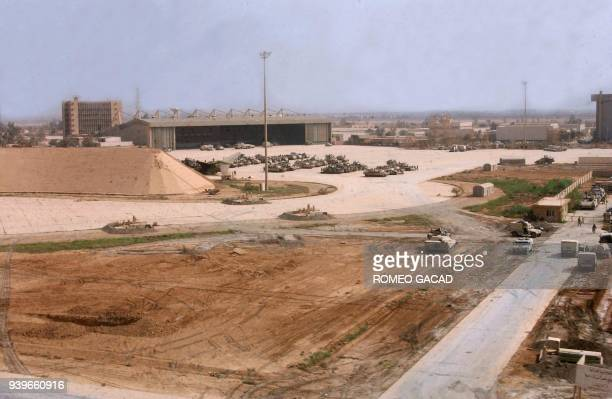 US Army tanks and armor vehicles occupy the tarmac of Baghdad's captured international airport 05 April 2003 after US Army troops from the 3rd...