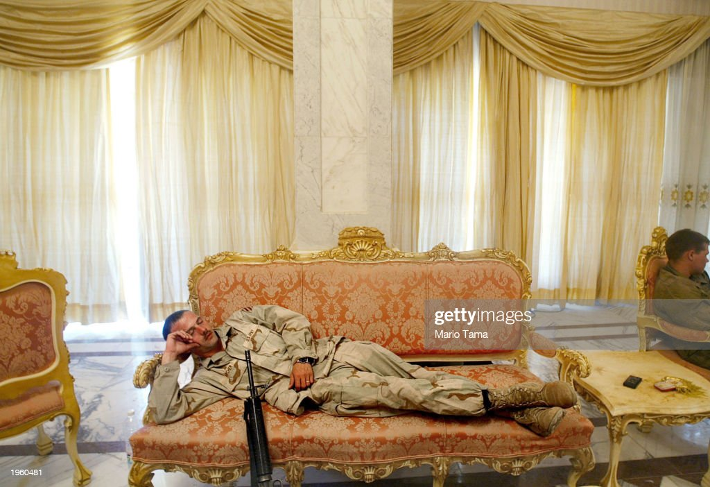 U.S. Army Third Infantry Division Sgt. Roscoe Archer of Fort Stewart, Georgia catches a nap on a couch in the Republican Presidential Palace April 14, 2003 in Bagdhad, Iraq. The compound is now guarded and has been secured by the U.S. military.