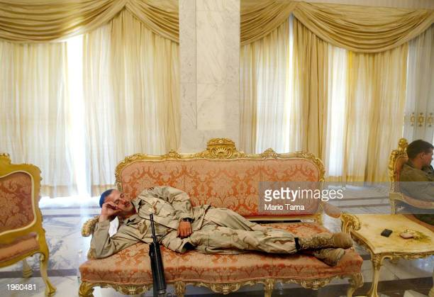 Army Third Infantry Division Sgt. Roscoe Archer of Fort Stewart, Georgia catches a nap on a couch in the Republican Presidential Palace April 14,...
