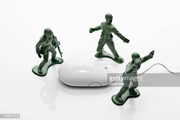 3 army toy army men and computer mouse