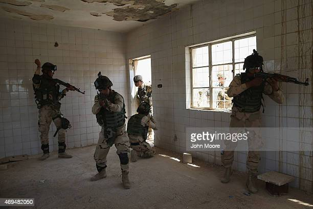 Army trainer , instructs Iraqi Army recruits at a military base on April 12, 2015 in Taji, Iraq. U.S. Forces, currently operating in 5 large bases...
