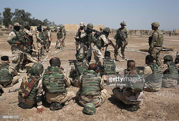 Army trainers instruct as Iraqi Army recruits at a military base on April 12, 2015 in Taji, Iraq. Members of the U.S. Army's 5-73 CAV, 3BCT, 82nd...