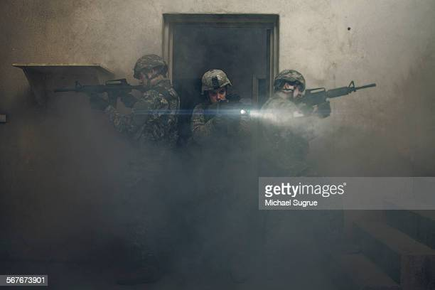 army troops advance a position in combat. - machine gun stock pictures, royalty-free photos & images