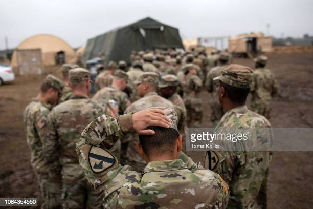 S Army troops deployed to the USMexico border line up to receive a Thanksgiving meal at a base near the DonnaRio Bravo International Bridge on...