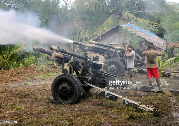 Army troops fire a 105 mm Howitzer canon into Moro Islamic Liberation Front positions in Aleosan, North Cotabato Province, southern Philippines on...