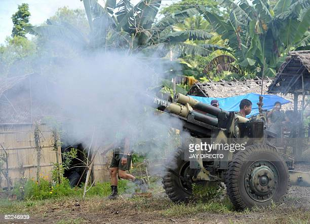 Army troops fire a 105 mm Howitzer canon into Moro Islamic Liberation Front positions in Aleosan North Cotabato Province southern Philippines August...