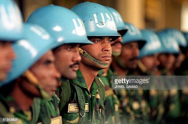 Army troops listen to their commander at Bangladesh's Zia International Airport 05 December 2000 prior to join UN Assistance Mission in Sierra Leone...