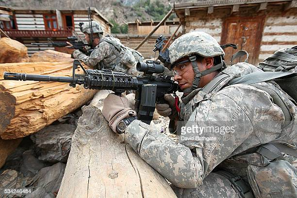 US Army troops of the 10th Mountain Division secure the perimeter of Barge Matal while Charlie Company searches for Taliban insurgents