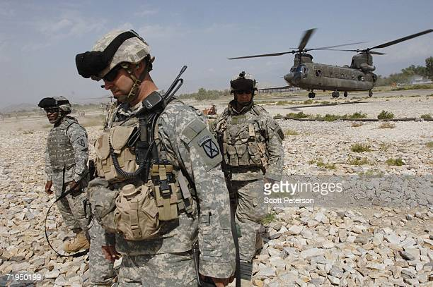 Army troops of the 10th Mountain Division wait for their Chinook helicopter to refuel, while deploying to a base near the eastern Afghanistan border...