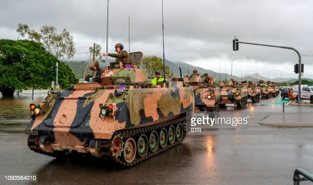 Army vehicles enter Townsville to help evacuate floodaffected people on February 4 as the recent downpour in Australia's tropical north has seen some...