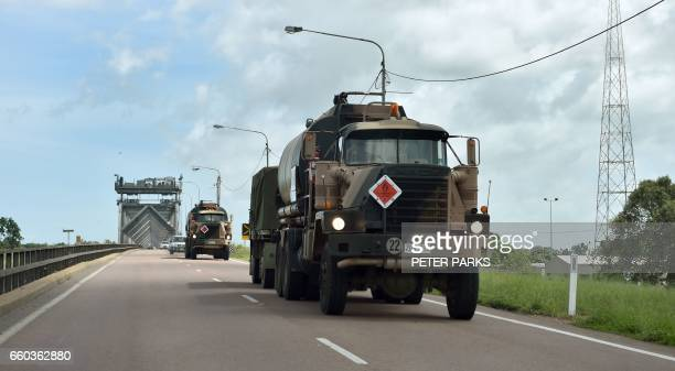 Army vehicles leave the town of Ayr headed to Bowen for relief efforts on March 30 after the area was hit by Cyclone Debbie Torrential rain hampered...